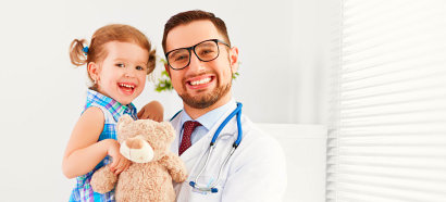 a pharmacist holding a child