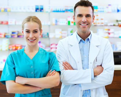 a male and a female pharmacist smiling
