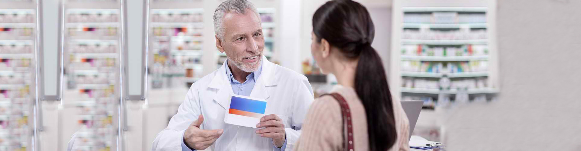 a pharmacist giving the customer her medicine