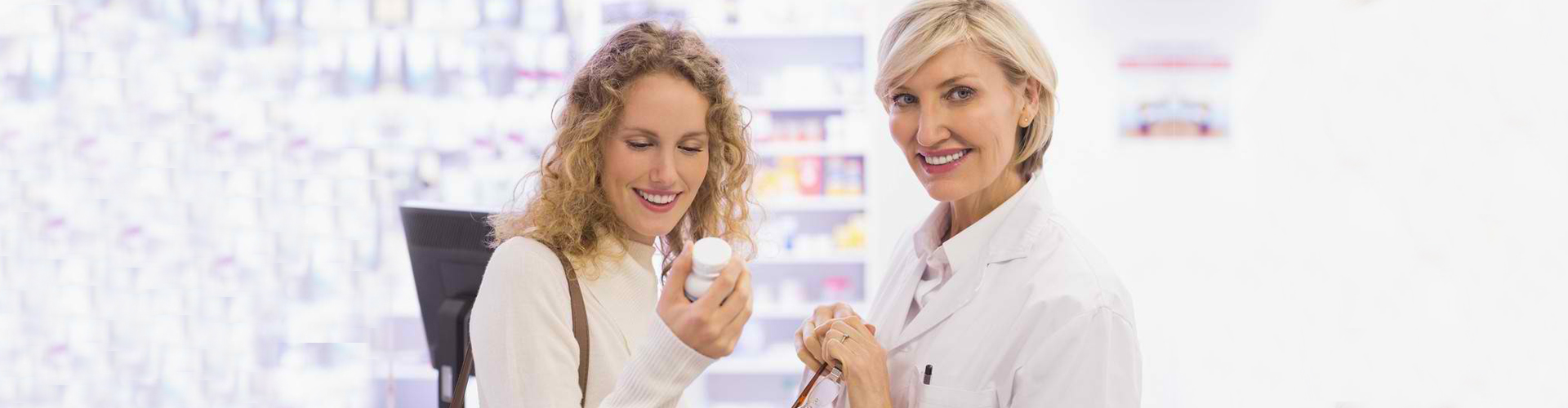 a pharmacist givivng medicine to her customer