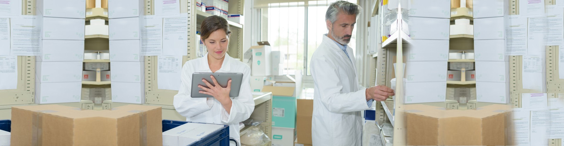 two pharmacists checking the inventory